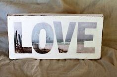 letters cut from a photo and modpodged on to a piece of wood.