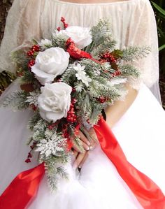 Make the red a maroon color and give all the bridesmaids similar bouquets but make the flowers maroon instead of white.