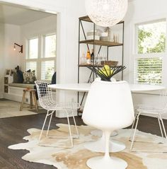 Bertoia Side Chairs, Moooi-Random Light, Modern Dining Room, White Dining Room, Lauren Combs house, Cow Hide Rug,  Knoll-Saarinen Round Dining Table, Knoll-Saarinen Armless Tulip Chairs,