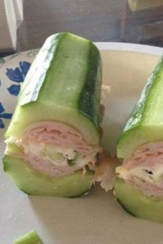 cucumber subs with turkey, cheese, & green onions. Other filling ideas: http://www.grocerybudget101.com/content.php/651-Cucumber-Subs - or try this lettuce-wrap sandwich: http://www.pinterest.com/pin/261560690832764758/
