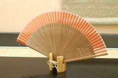 Authentic Japanese Hand Fan - Karaki #2!!!! $25.00  The Japanese hand fans are an important symbol in Japan . They were used by warriors as a form of weapon, actors and dancers for performances, and children as a toy. In Japan fans are given to others as present and serve as trays for holding gifts. You would also find them sometimes used in religious ceremonies and events.