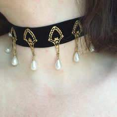 Ornate Brass, Pearl and Ribbon Choker Necklace, this piece was seen on Queen Elizabeth on Reign. Inspired by the costume design on Reign, the Renaissance, European history. Happy to add a longer extension upon request at no charge. This piece is made to order and can ship in about a week.  ~~~~~~~~~~~~~~~~~~~~~~~~~~~~~~~~~~~~~~~~~~~~~~~~~~~~~~~~~~~~~~~~~~~~~~~~~~~~~~~~~~~~~~~~~~~~~~~~~~~~~~~~~~~~~~~~~~~~~~~~~~~~~~~~~ I produce unique costume jewelry for TV, Film and Theatre, specializing in…