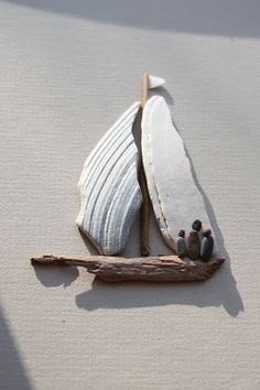 sharon nowlan pebble art - Why didnt I ever connect broken clam shells with being the perfect sails for my driftwood sailboats? DUH! Brilliant!!.....vwr?
