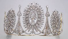 An amazing diamond tiara, with at least three large honeysuckle motifs surrounded with diamond radial arms, and tall spacers with floral motifs.