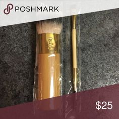 New tarte makeup brushes 1 tarte powder brush. And 1 tarte double sided brow brush.  Super soft and luxurious bristles.  Bamboo and gold handles.  Bundle and save! tarte Makeup Brushes & Tools