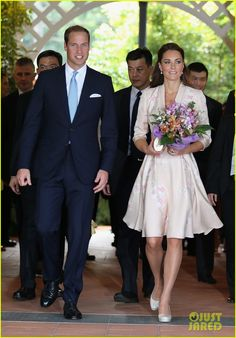 Flashback. A wonderfully attired duo here. The UK's Prince William and Princess Kate. I love this trumpet dress.