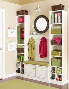Love the idea of using purchased bookcases, etc., together to look like built-ins. DIY home improvement for a mudroom: 35 dollars for the two bookcases, and some baseboard trim to make it look like a great built in. All this can be purchased at Lowes. Billy Regal, Baseboard Trim, Baseboards, Diy Casa, Wall Storage, Storage Ideas, Entryway Storage, Organized Entryway, Storage Solutions