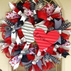 Valentines Day deco mesh wreath with metal hearts and Love arrow