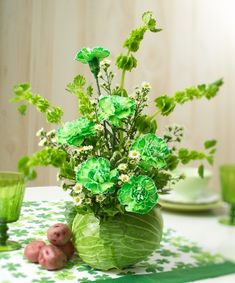 Learn how to make a DIY St. Patrick's Day floral arrangement using cabbage and green flowers! Flower Expert Jerry Rosalia shows you how on Petal Talk! St Paddys Day, St Patricks Day, St Pattys, Floral Design Classes, Floral Designs, Green Carnation, Unique Flower Arrangements, St Patrick's Day Decorations, St Patrick's Day Crafts