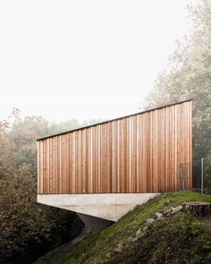 The facade of upper body is cladded with wooden laths to create a sort of vibration once lit by the sun photo by: Wood Architecture, Contemporary Architecture, Architecture Details, Sun Projects, Wood Facade, Wood Siding, Concrete Wood, Facade Design, Exterior Design