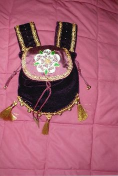 Burgundy velvet and silk pouch, embroidered with the White Rose of York in silkwork and goldwork