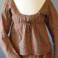 Roller Printed 1820's two piece in a red in alternating small blue and green squares  .... the skirt with gathered front sides and all the back, an indigo check waistband, two brass hooks to the front sides and five brass eyes to the back, two side slits lined with green linen tape....  http://www.meg-andrews.com/item-details/Dutch-Printed/7533