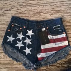 High waisted jean shorts Never worn NWT patriotic shorts. Put brandy Melville bc they are similar style. Got these for $40, selling for $20. Awesome deal! Brandy Melville Shorts Jean Shorts