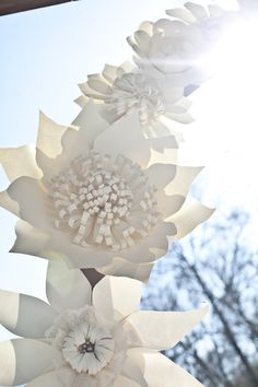 paper flower wedding arch for your ceremony http://www.weddingchicks.com/2013/09/18/eclectic-spring-wedding/