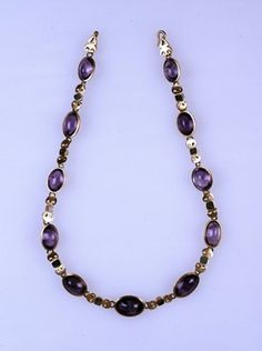 Gold necklace set with amethysts and plasma. The stones are linked with gold peltae (Amazons' shields).