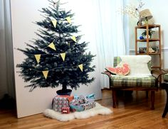 When you don't quiet have enough room for a tree - DIY Stretched IKEA Christmas Tree