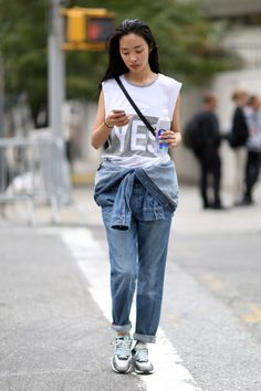 Keeping cool in halfway rolled down overalls. #NYFW #Offduty