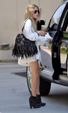 Image from http://i1075.photobucket.com/albums/w422/olsensanonymous/Olsens-Anonymous-Blog-Mary-Kate-Olsen-Black-And-White-LA-Fringe-Bag-Wedge-Boots.jpg.