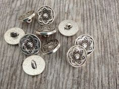 A personal favorite from my Etsy shop https://www.etsy.com/listing/257787402/small-15mm-silver-tone-floral-design