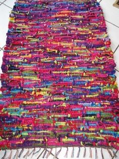 I bought ALOT of rag rugs that look just like this for $1.00 at Menards! Love them.