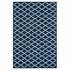 Add a contemporary update to your home with this hand-tufted rug, featuring a tessellated design. Team with bare wood floors and neutrals walls to complete the look.  Product: RugConstruction Material: 100% WoolColour: Dark blue and ivory Features: Hand-tuftedNote: Please be aware that actual colours may vary from those shown on your screen. Accent rugs may also not show the entire pattern that the corresponding area rugs have.Cleaning and Care: Vacuum regularly