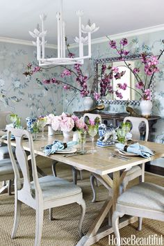 Elizabeth Bauer Watt - House Beautiful De Gournay Chinoiserie wallpaper, an oak dining table, an antique mirror, and antique Swedish chairs create a wonderful dining room. Other Chinoiserie touches in