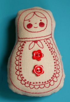 Embroidered Matryoshka Doll.  Add a ribbon at the top and this would be an adorable ornament.
