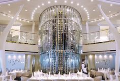 """@CelebrityCruises Solstice - in the main dining room. The magnificent chandelier is right behind the Captain's Table and right in front of the enormous wine """"cabinet."""""""