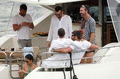 George and Favi on a yacht with friends