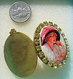 $65 Vintage locket with porcelain center cameo of Harrison Fisher Art known as 'Refreshments'. Victorian lady in a big floppy pink hat sipping so...
