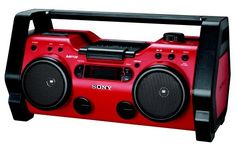 Sony ZSH10CP Portable Heavy Duty CD Radio Boombox Speaker System (Red) (027242683761) Rugged jobsite CD boombox with water- and dust-resistant plastic housing Protective safeguard bar keeps boombox safe from stacking items and falling debris CD playback modes include track programming, repeat play, and shuffle play Digital, drift-free AM/FM tuner; auxiliary input for digital music players Measures 20.12 x 9.6 x 6.06 inches (W x H x D); 1-year parts warranty - - Batteries are D cells - not C…