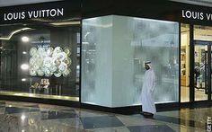 A man walks past a designer outlet, Dubai travel guide