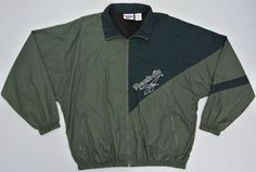 Up for sale is a pre owned vintage 90s Reebok windbreaker. (Please note the dark green color is a lighter) 100% nylon. Made in Thailand. Good used