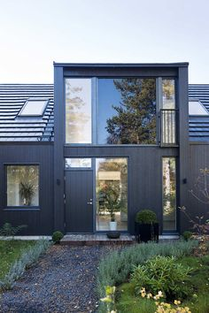 """This contemporary home by Johan Sundberg was created for a couple in a seaside resort area called Höllviken, Sweden. The house was designed to satisfy building regulations, as well as the clients, while maintaining the integrity of the site's natural landscape. Villa Lima by Johan Sundberg: """"Höllviken south of Malmö is originally a seaside summer resort. A young couple wanted to build a house on a traditional summer house lot that had to be very modern, and at the same time ..."""