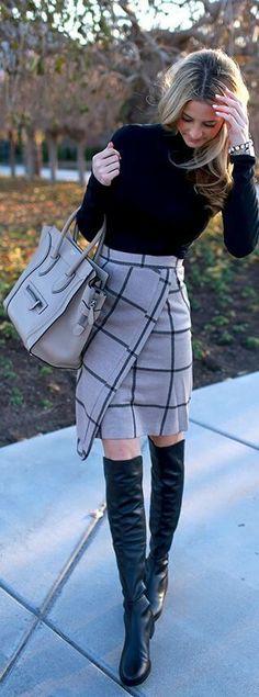 Chic blonde in black turtleneck top and grey wrap woolen skirt