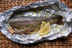 This easy oven baked trout recipe always gets rave reviews. Baking whole trout in foil packets helps the fish cook perfectly. A quick, 20 minute recipe!
