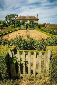 I would take this stunning garden formal landscape with roses in a heartbeat. I would have to trade the grass for Kentucky Bluegrass.