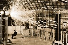 Nikola Tesla in his Niagara Falls lab with his Tesla coils, which could discharge millions of volts and transmit electricity through the air. Here, they're producing 25-foot-long sparks.