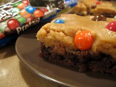 Peanut Butter Cookie Dough Brownies with Pretzel M's...or mini PB cups...or Oreo chunks...