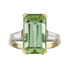 A green tourmaline and diamond ring, the emerald-cut tourmaline, weighing carats, four claw set to the centre of two tapered baguette-cut diamond shoulders set in 18 ct gold from Bentley & Skinner Diamond Rings For Sale, Gold Diamond Rings, White Gold Diamonds, Gold Rings, Green Engagement Rings, Vintage Engagement Rings, Tourmaline Jewelry, Green Tourmaline, Gold Jewelry