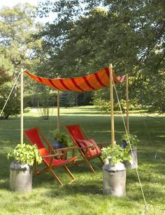 Ideal for super sunny days, here's a tutorial on how to make an outdoor canopy using closet poles, wood jugs, and cloth. Can't find milk jugs? Fill half wine barrels with dirt and mount the poles in them!