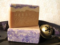 I love it!   A fancy, script soap stamp, she used mica and a pretty layerd soap with swirls, a nice combo of decorative techniques.