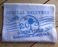 "Mothers love our flour sack towels so much they've started using them with baby.  These 100% cotton flour sack towels are super soft for baby's skin and work great as a cloth diaper or burp cloth.  Each one is hand printed for your ""Special Delivery""  Available in pink or blue.  www.163designs.com"