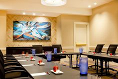 A simple boardroom setup encourages attendees to engage and collaborate with each other.