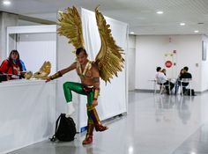 Diego Vargas puts on the boots for his Hawkman costume while attending New York Comic Con in New York. The pop culture convention, featuring the latest in comics, graphic novels, anime, manga, video games, toys, movies and television, runs through to Sunday.