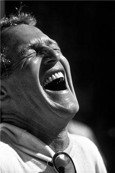 Paul Newman laughing © AL SATTERWHITE, 1974 September 1974 -- Bonneville Salt Flats, Utah