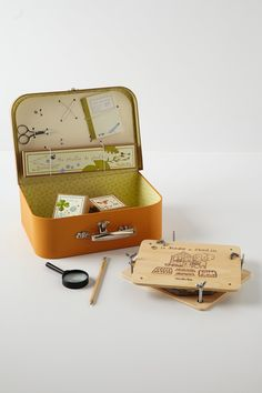 Childs Activity Kit - Anthropologie.com  French toymaker Moulin Roty encourages mini-Magellan's with this child¿s exploration kit. Including a compass, magnifying glass, canvas satchel, notebook and pencil, set of collapsible binoculars and guide for tying sailor's knots, it can be forever cherished.
