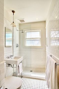 Where I can find a glass shower wall like this? a glass supplier. They should come out, measure, create a template and cut it custom for you. I have done this. I sourced a piece of housing from the shower screen supplier. It ran Vertically down the tile to the height of glass. Nothing on the bottom - only the silicon on each side. Looks fantastic and is soooo easy to clean.