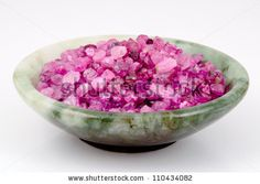 A pile of rough, uncut rubies in a jade bowl. by Imfoto, via ShutterStock
