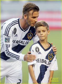David Beckham gives his son Romeo a kiss on the head while celebrating his 10th birthday during a pre-game ceremony on Saturday (September 1) in Carson, Calif.